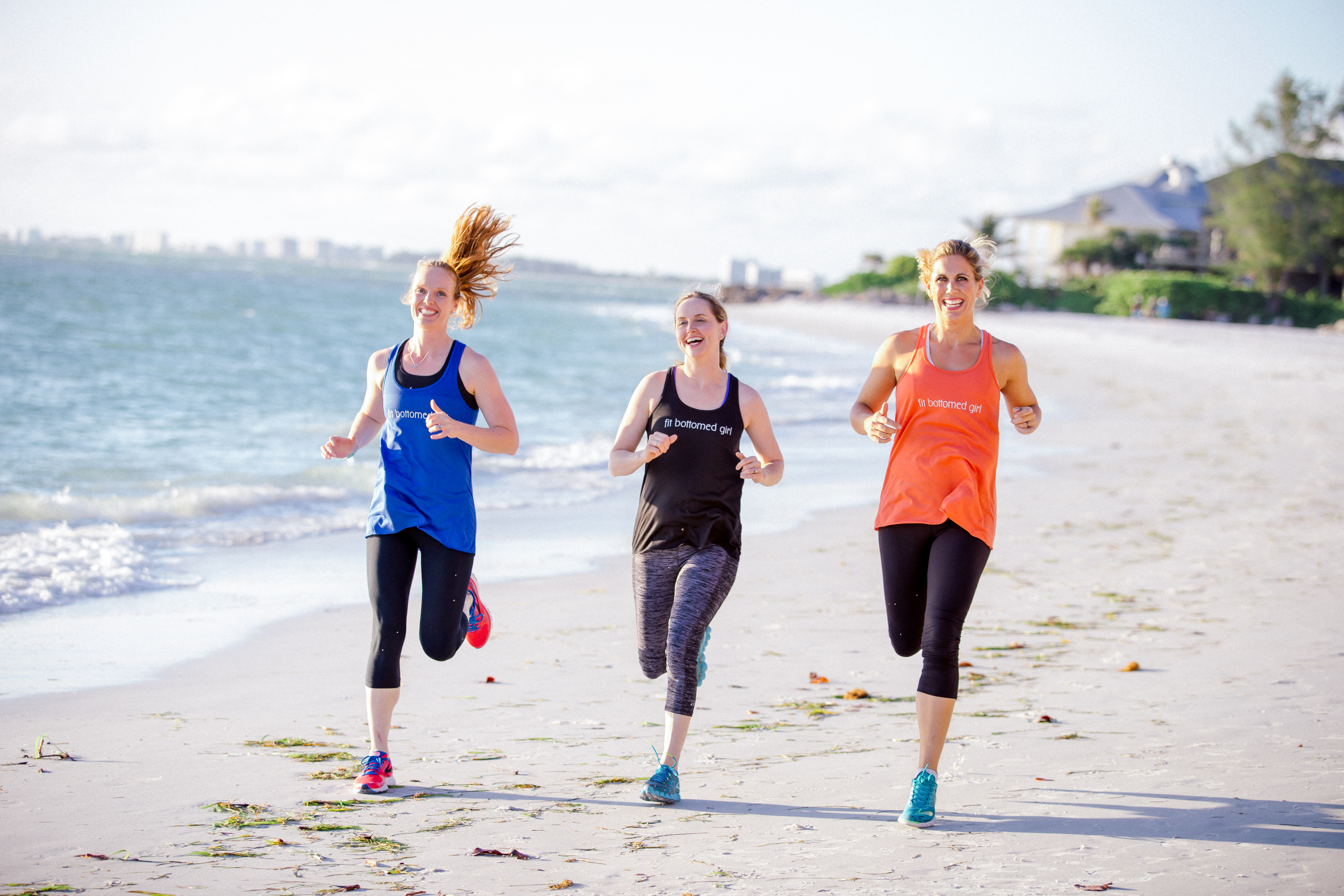 Fit Bottomed Girls running on a beach featured in KR Edit's #MyUrbanIsland interview, talk fitness and more